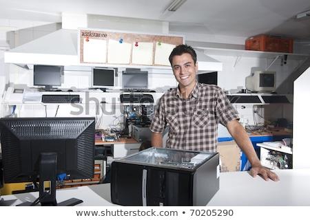 Professional repairman repairing computer in workshop Stock photo © Elnur