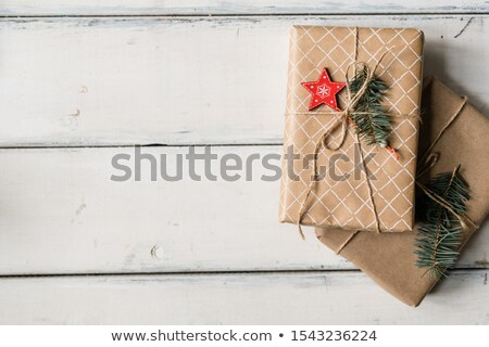 Stack of two wrapped giftboxes bound with threads on white table Stock photo © pressmaster