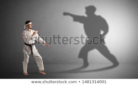 biznesmen · oferowanie · superhero · cień · skromny · człowiek - zdjęcia stock © ra2studio