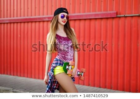 red haired teenage girl with short skateboard stock photo © dolgachov