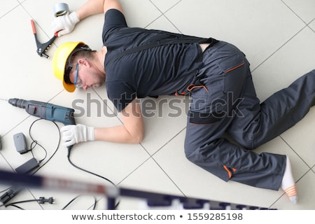Inconsciente handyman piso escada equipamento homem Foto stock © AndreyPopov