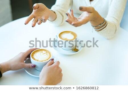Kezek fiatal női beszél barát elöl Stock fotó © pressmaster