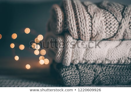 Stack of cozy knitwear in winter time Stock photo © dashapetrenko