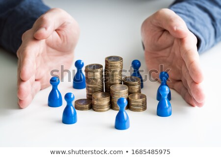 Protecting Blue Human Figures Surrounding Stacked Coins Stock photo © AndreyPopov