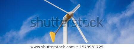 Wind turbines generating electricity with blue sky - energy conservation concept BANNER, LONG FORMAT Stock photo © galitskaya