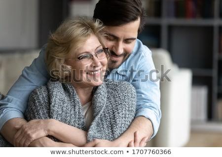 Anne oğul beyaz tshirt yalıtılmış Stok fotoğraf © pekour