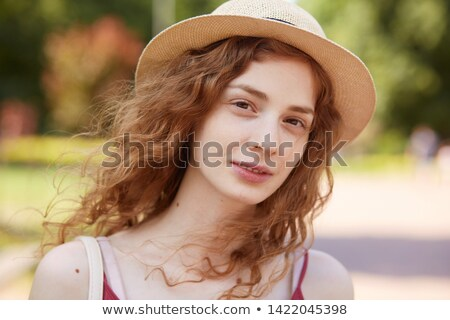 young brown haired woman with straw hat stock photo © photography33