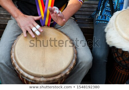 boy and girl playing djembe stock photo © photography33