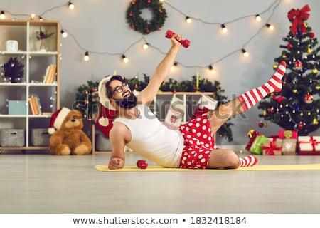 muscle shaped underwear man with weight on gym stock photo © lunamarina