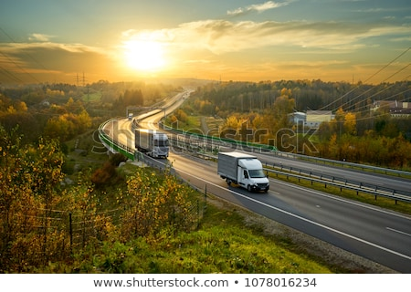 Trucks, delivery vans on freeway Stock photo © photocreo