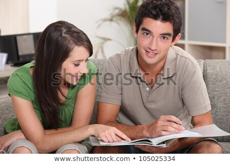 young couple at home skimming through catalogue Stock photo © photography33