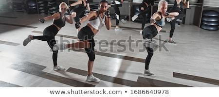 Stock photo: Girl training body combat