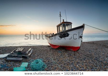 Vissersboot schilderachtig hemel water wolken Stockfoto © morrbyte
