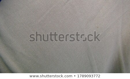 Background of crumpled dense fabric colored in beige tones Stock photo © ozaiachin