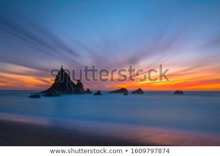 Tan gün batımı plaj uzun pozlama kaya kaya oluşumu Stok fotoğraf © 3523studio