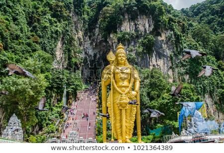 giant statue of lord murugan at batu caves temple in kuala lumpur malaysia stock photo © haiderazim