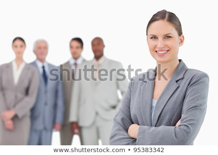Row of business associates behind smiling woman Stock photo © stockyimages