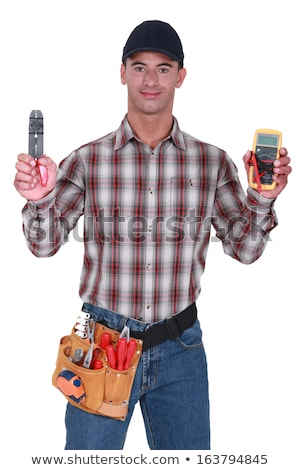 Man holding wire clipper and electrical current measure Stock photo © photography33