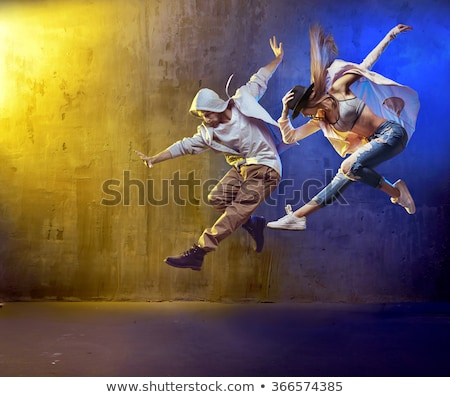 girl hip hop dancer in jump pose Stock photo © carlodapino