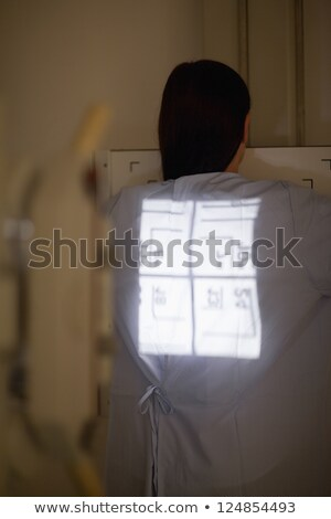 Stock photo: Radiography being proceed on a patient in an examination room