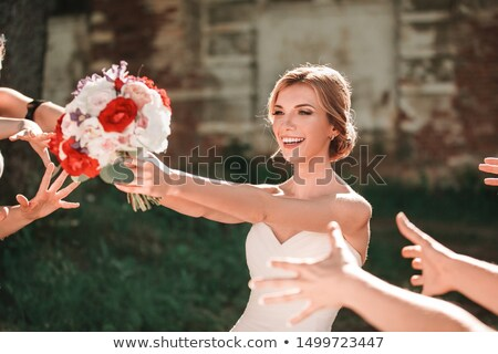 Bride tossing bouquet. Stock photo © iofoto