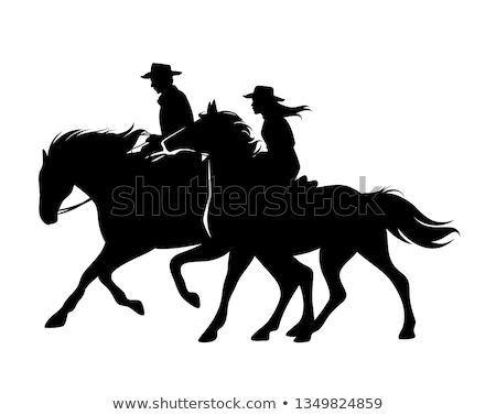 Stock photo: cowgirl riding horse silhouettes