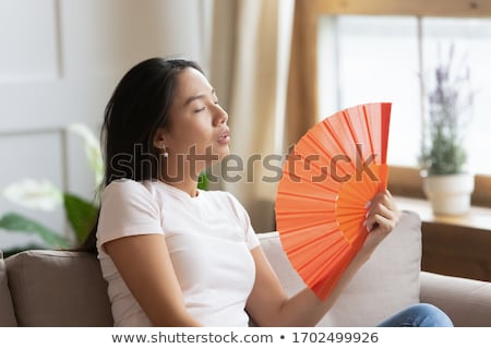 young asian woman with a fan  Stock photo © isaxar