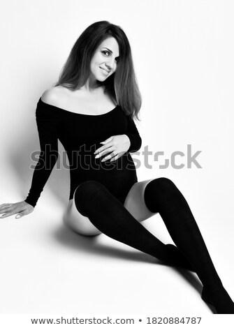 close up of females hand on black body stocking stock photo © pxhidalgo