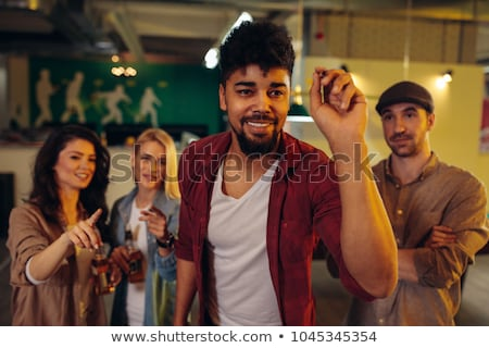 Group of friends playing darts Stock photo © Kzenon