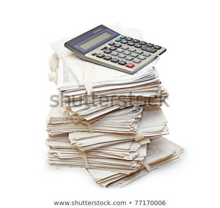 Stock photo: Pack of official papers with the calculator