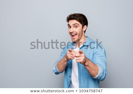 smiling guy pointing you out stock photo © stockyimages