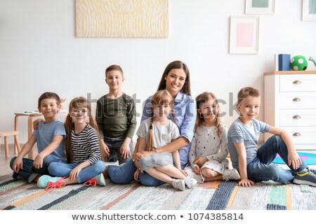 Portrait Of Group Of Primary Schoolchildren And Teacher Sitting  Stock photo © monkey_business