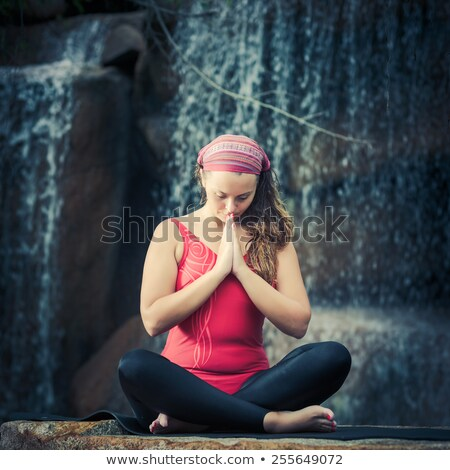 woman practices yoga in nature the waterfall sukhasana pose stock photo © geribody