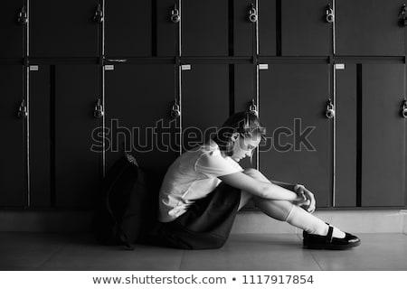 Gelangweilt junge Mädchen Schuluniform Sitzung Tabelle Kinn Stock foto © stryjek