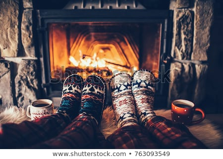feet of the couple warming at a fireplace stock photo © dashapetrenko