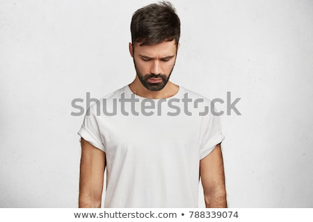 attractive fashion man looking down stock photo © feedough