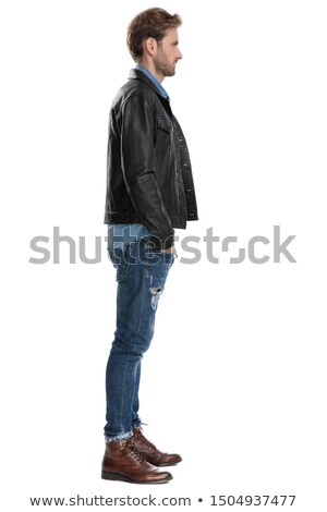 young man in leather jacket holding his hands in pocket Stock photo © feedough