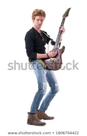 Erkek müzisyen oynama bas gitar saç Stok fotoğraf © feelphotoart
