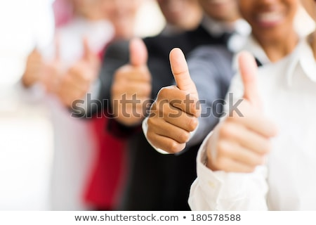 closeup portrait of a male hand with thumb up stock photo © deandrobot