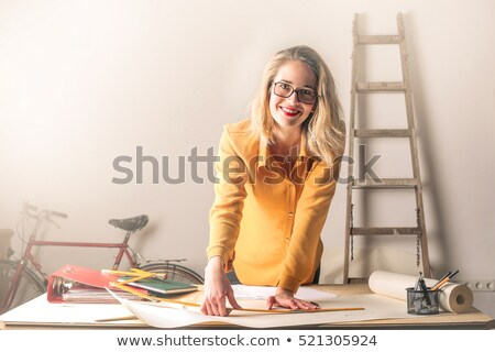 Woman with centimeter and paper binder Stock photo © Elnur