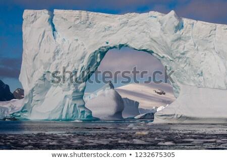 Ice arch - Antarctica Stock photo © benkrut