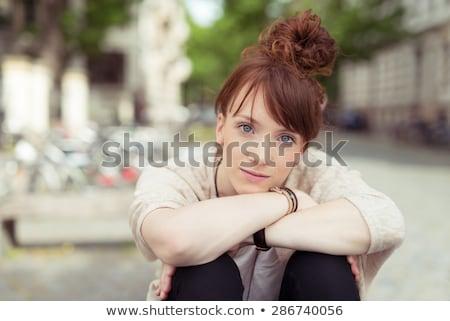 Jolie femme main menton genou joli Photo stock © dash