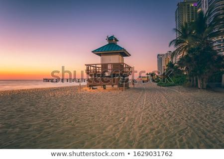 Sziluett napos tengerpart éjszaka tükröződés óceán Stock fotó © meinzahn