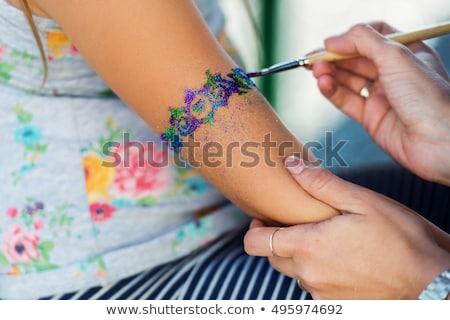 Schitteren tattoo kaukasisch zomer borstel vakantie Stockfoto © gabor_galovtsik