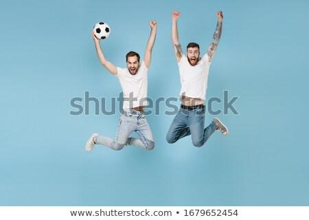 Doelverdediger Blauw springen omhoog witte voetbal Stockfoto © wavebreak_media