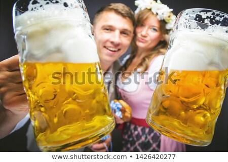 Oktoberfest dziewczyna uśmiechnięty kamery biały niebieski Zdjęcia stock © wavebreak_media