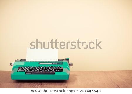 old retro typewriter on wooden desk stock photo © janpietruszka