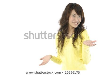 Kobieta interesu plecy biały patrząc kamery ręce Zdjęcia stock © deandrobot