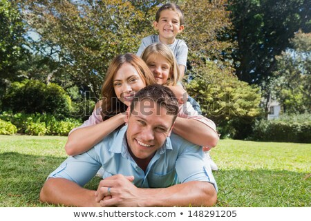 happy family members lying on each other stock photo © wavebreak_media