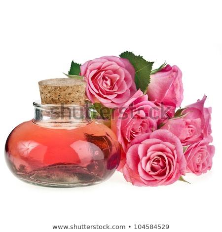 üveg lényeg olaj orgona virágok izolált Stock fotó © tetkoren